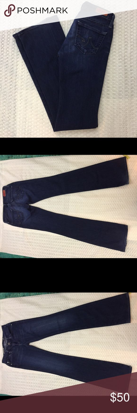 AG ADRIANO GOLDSCHMIED The Angel Bootcut Jeans AG jeans. The Angel style. Dark wash. Preowned, great condition. Minimal fraying at hem (probably came that way!) AG Adriano Goldschmied Jeans Boot Cut