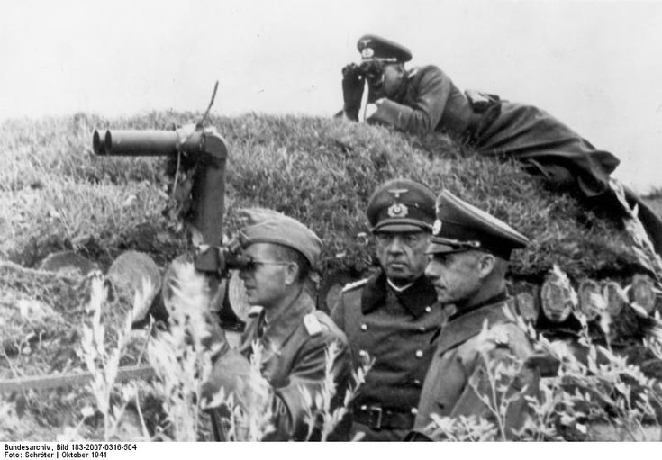 German observation position with two generals.Periscope binoculars in foreground. 	October 1941