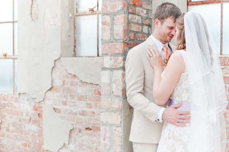 We are loving this neutral color scheme in this wedding photo captured by 3Eight Photography! Even the groom's tie complements the exposed brick behind them. Click the image to learn more about these wedding photographers. Photo credit: 3Eight Photography