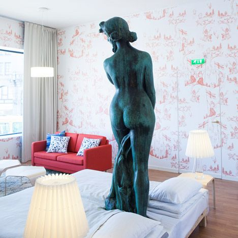 Boutique Hotel Room Was Built Around a Statue and Fountain