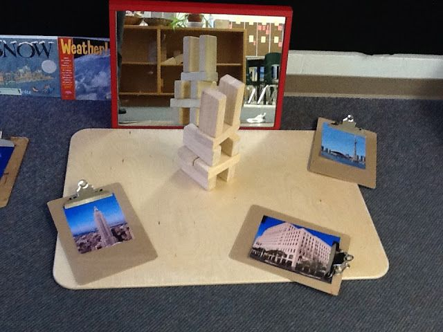 Block play with mirrors and pictures for inspiration
