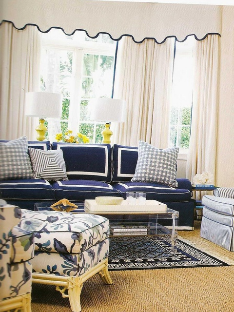 Celerie Kemble - draperies, navy couch with white taping, side chair with contrast welting, floral chaise, sisal rug