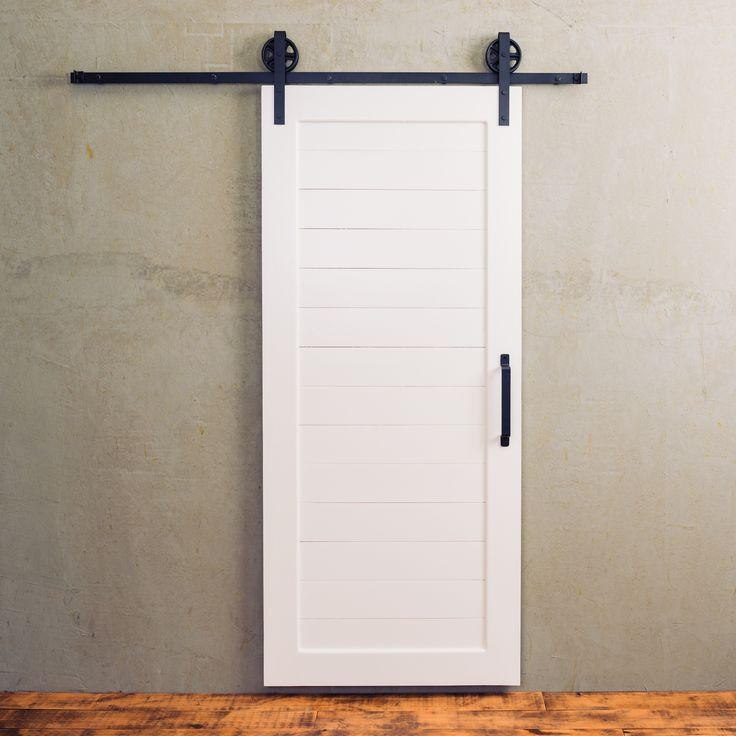 There 39 s something special about a simple white barn door for Single sliding barn door