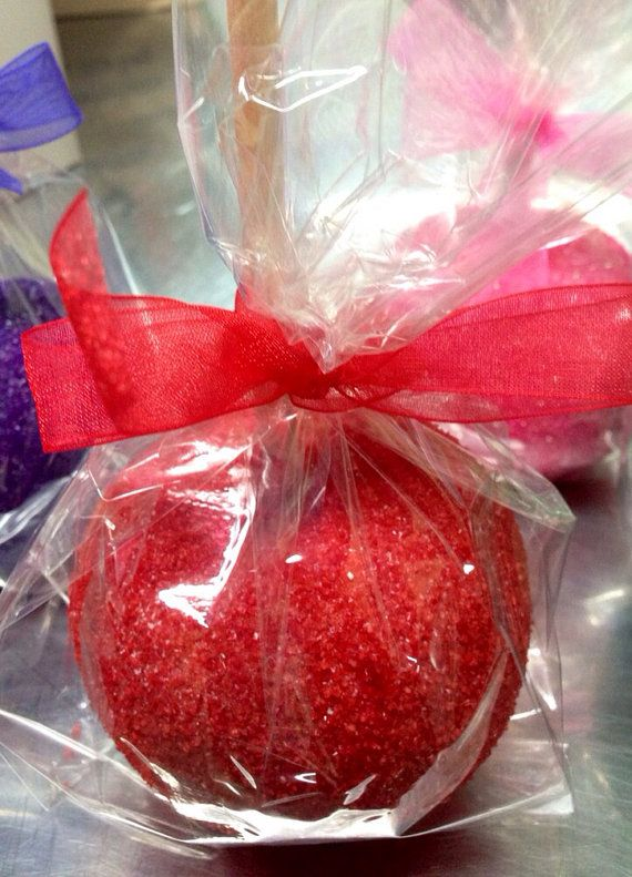 Customized by color! Delicious red candy, chocolate or caramel apples dripping in sugar glitter color of your choice. We can also decorate in