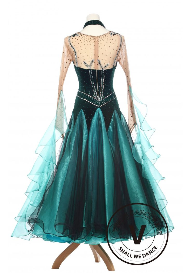 The mesh completely covers the chest, upper back and arms. Velvet than takes a strike again in a sweetheart appeal connected under the mesh portion, having major delicacy. Green studs surround the velvet until the waist approaches, silver studs start to appear again in an orderly fashion around the waist. The gown starts protruding into a flaring elegance to the floor.