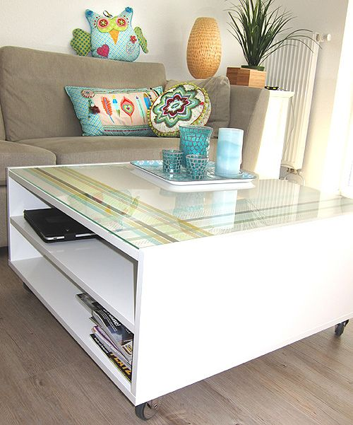 i love this Ikea Boksel coffee table topped with glass, so many options! $139.  (here it is shown with some added washi tape)  http://www.ikea.com/us/en/catalog/products/30207155/
