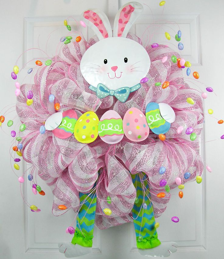 """A premium deco mesh wreath with pink and white stripes, whimsical egg picks and a bunny makes this a fun way to celebrate Easter! Measures 36""""H X 28""""W."""