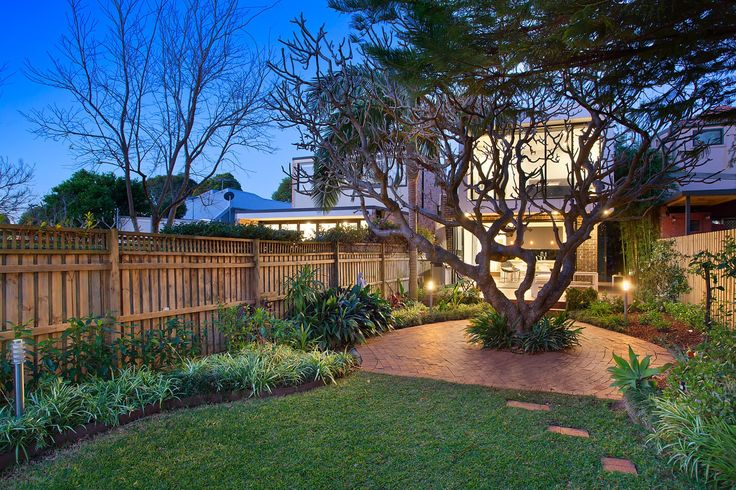 Large private garden with level lawn and trees