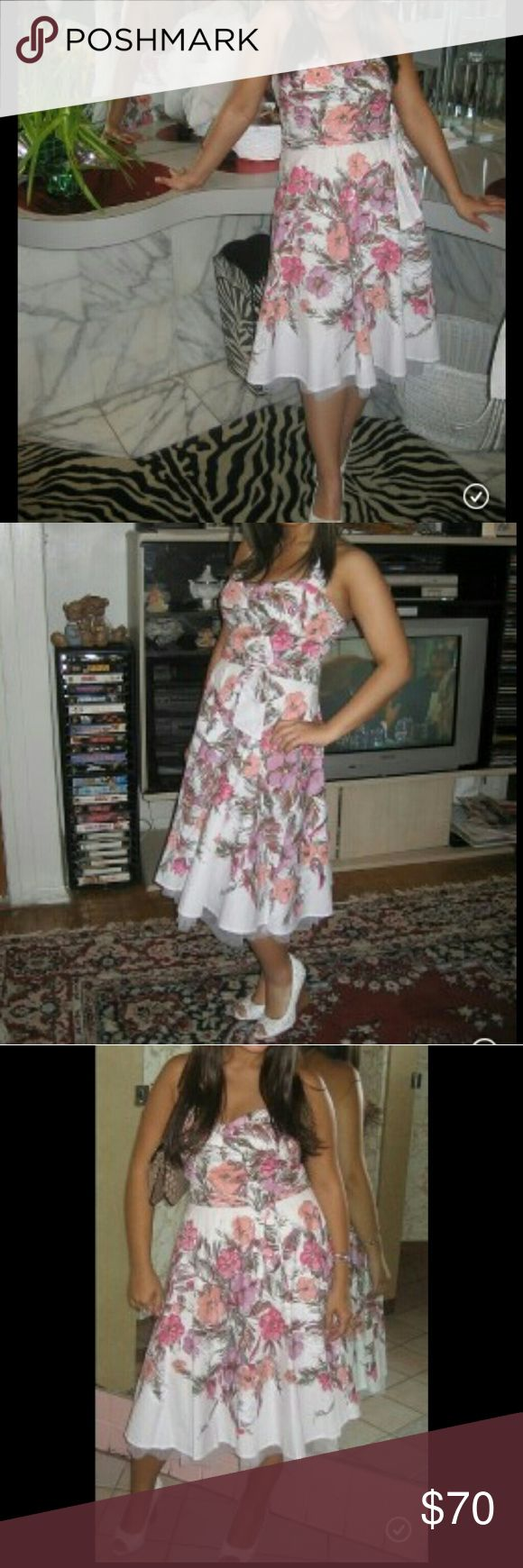 Guess floral party dress Worn 1x in perfect condition ... beautiful guess party dress has some sequence on the flowers has tool  the bottom Guess Dresses Midi