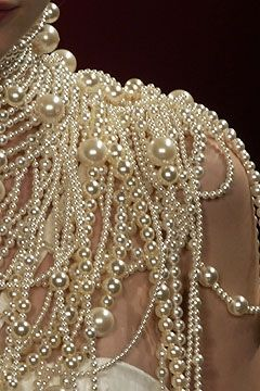 Cascading, creamy over-the-top pearl couture collar on the runway