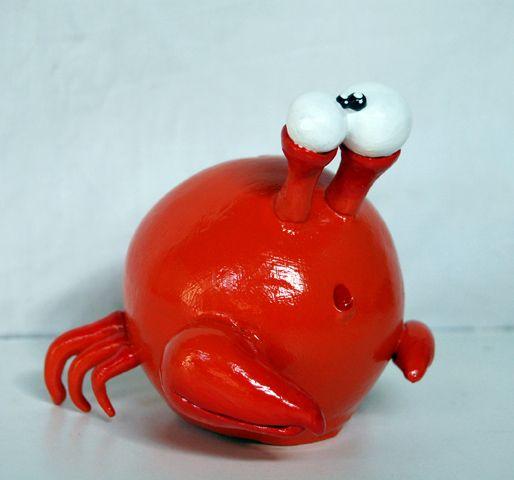 Alcancía cangrejo en porcelana fría y pintada a mano. Salvadanaio granchio in porcelana fría e dipinto a mano.