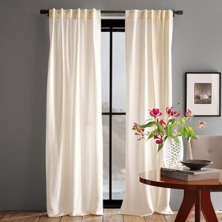 LOVE these white curtains with the gray walls.