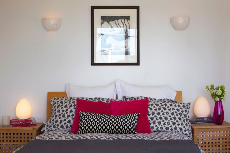 #Stylish bedroom. #pink and black. #egg lamps #Pink vase. Staging by Places and Graces.