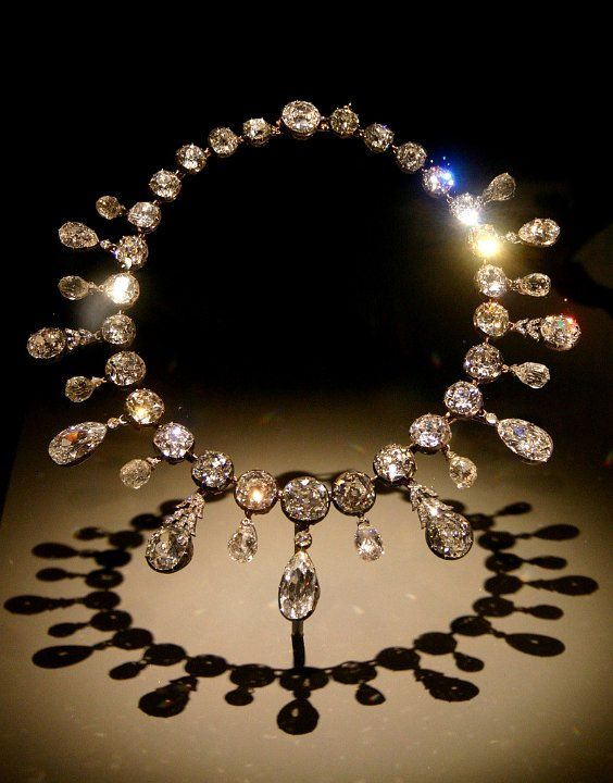 The Napoleon Diamond Necklace: A row of 28 mine-cut diamonds with a fringe of alternating pendeloque and briolette diamonds. Each briolette mounting is set with 12 rose cut diamonds. Commissioned for Empress Marie-Louise by Napoleon I upon the birth of his son and heir.