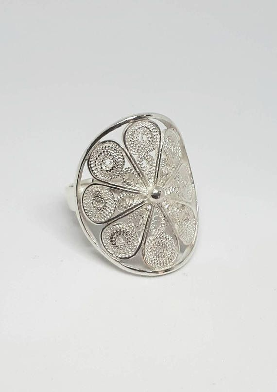 Check out this item in my Etsy shop https://www.etsy.com/uk/listing/506789527/flower-jewellry-flower-ring-filigree
