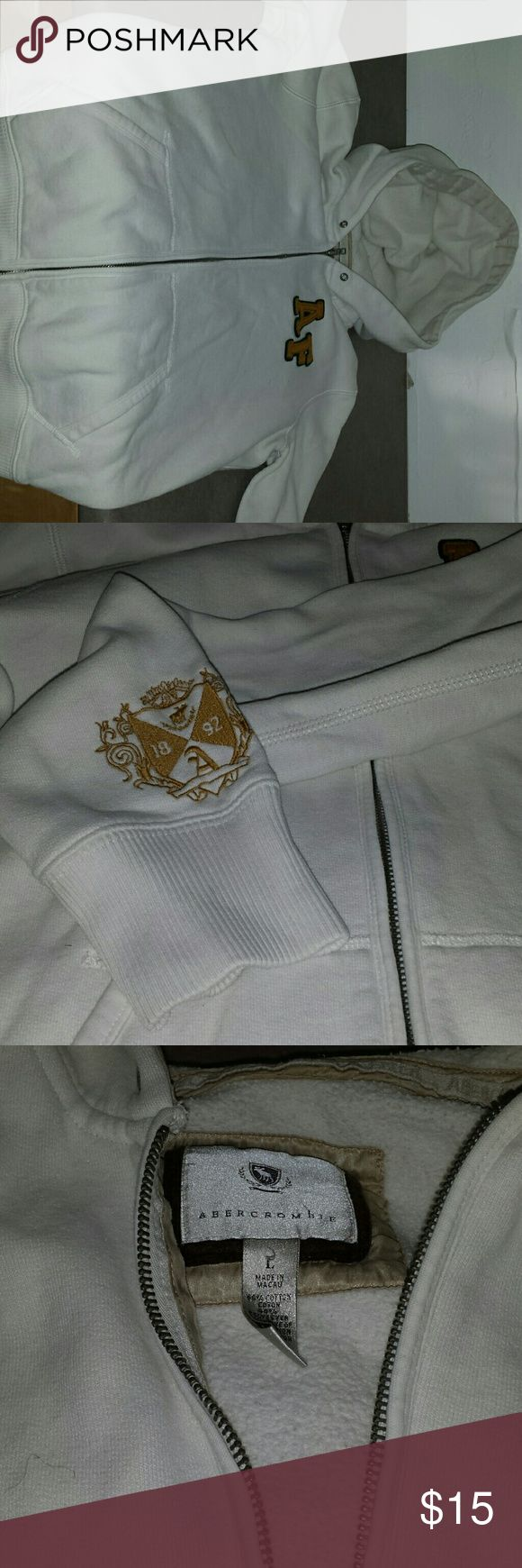 A&F white zip up hoodie. A&F unisex large white zip up hoodie. Has emblem on left cuff as seen in pic. Has a dble zipper. No tears or holes. Abercrombie & Fitch Sweaters