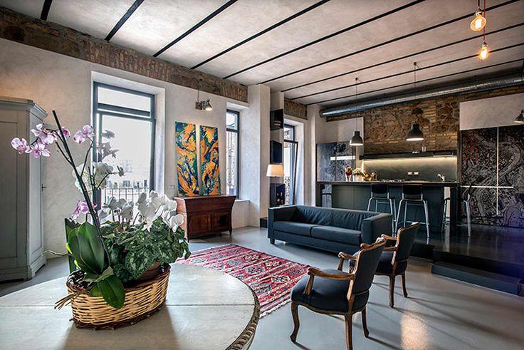 Quartiere Ostiense: una casa dal sapore Industriale : Soggiorno in stile in stile Industriale di studioQ