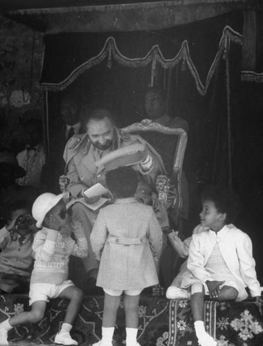 HIM with the young Princes  Emperor Haile Selassie of Ethiopia playfully interacting with his grandchildren.
