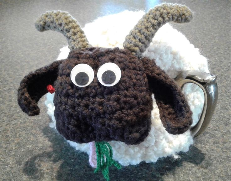 "Funky Crochet ""WILLUM"" (Billy) Goat Tea Cosy Wool/Alpaca Yarn - Googly Eyes & Cotton ""Grass"" and Ear Tag - Unique Design -  Great Range of Tea Cosies and Tissue Box Cosies all Uniquely designed by Bar-Bar-A-Black Sheep. Sheep, Goats, Cows, Elephants, Cats, - In stock or made to order in Wool, Alpaca, Acrylic or Cotton.  For sale on etsy.com barbarablacksheepau or Madeit.com barbarablacksheep."