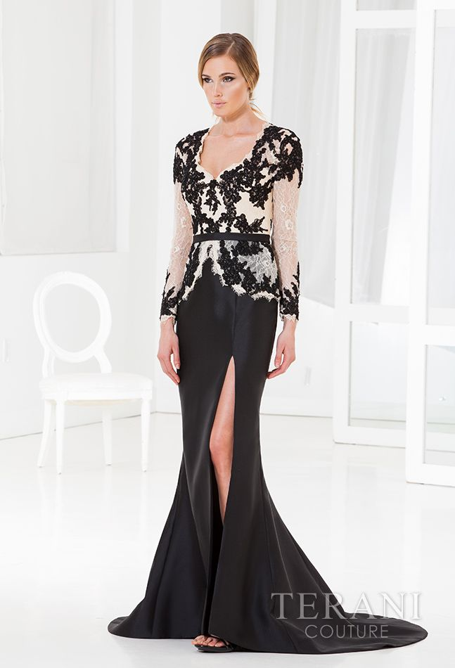 Satin evening gown with a lace peplum top that is finished with a raw scalloped edge along the v-neck, peplum, and cuff. The top is detailed with sequined floral appliques along the bodice and sleeves.