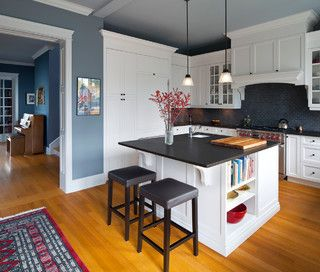 Kitchen, bright blue walls, white cabinets, subway tile, absolute black granite counters