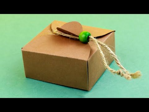 In this tutorial we'll show how to fold a cardboard box quickly and easily! #origamibox #scrapbooking #papercrafting