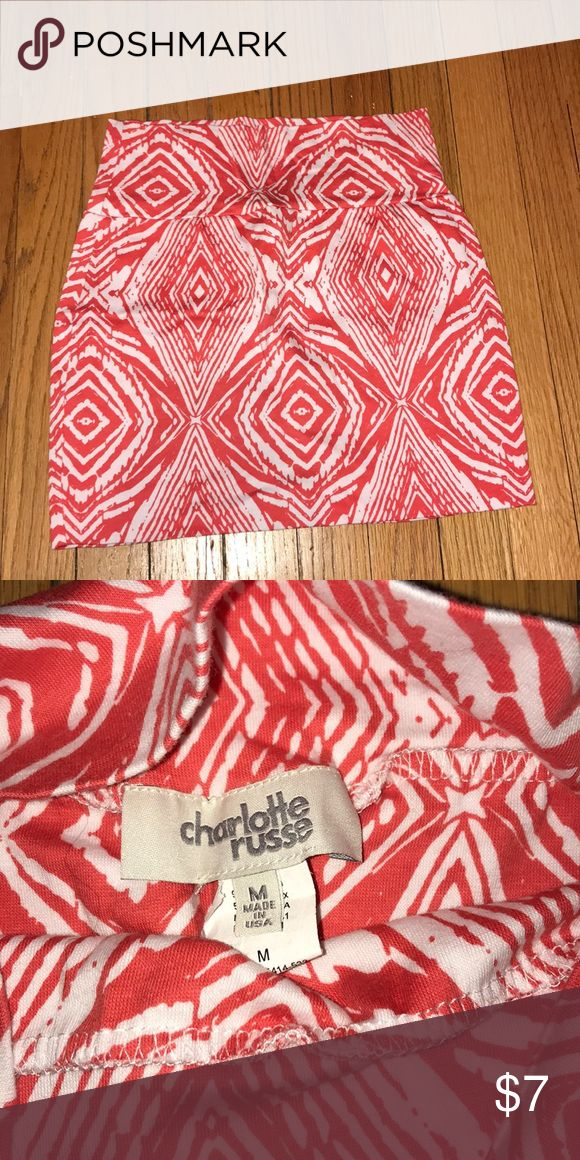 Orange Tribal Print Skirt Fun Orange and White printed skirt! Body in style. Never worn before - perfect condition and very comfortable fabric. Charlotte Russe Skirts Mini