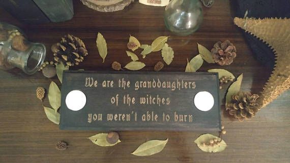 Handcrafted in Montreal.  This pretty candle holder is black stained and carved with Tish Thawers quote We are the granddaughters of the witches you werent able to burn. Measurements (inches) : approx. 12.5x4x3/4 Can hold two 1.5 inch wide candles (2 white tea candles included)