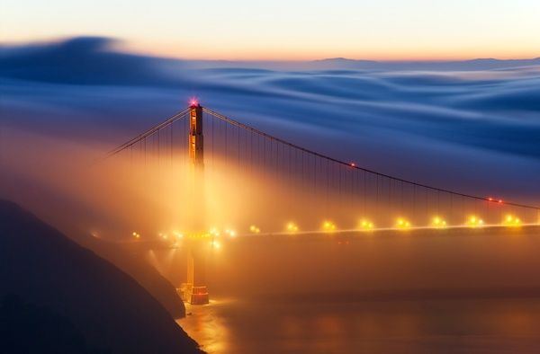 """Photo of the Day - May 8, 2012: """"The rolling fog over the North Tower of the Golden Gate Bridge."""" Javier Acosta (San Jose, California) Photographed January 2010, Golden Gate Bridge, San Francisco, California"""