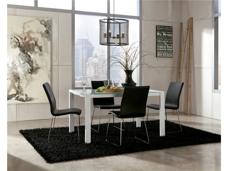 Add a tough of sophistication & style to your eating area with this modern table and black leather chairs