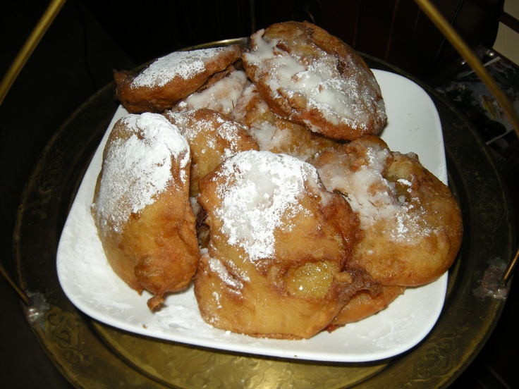 Dutch food: appelflappen (apple in dough fried in oil, with icing suger). Mostly eaten in winter and at New Year's Eve.