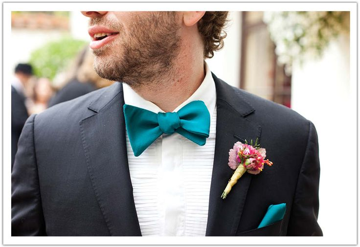 Blue bow tie complemented by a bout with a pop of pink. By Alchemy Fine Events www.alchemyfineevents.com