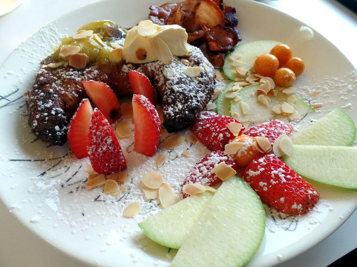 French toast brioche stuffed with nutella with fresh fruit from Superette