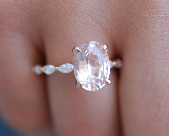 Unconventional engagement ring. Oval engagement ring. Rose