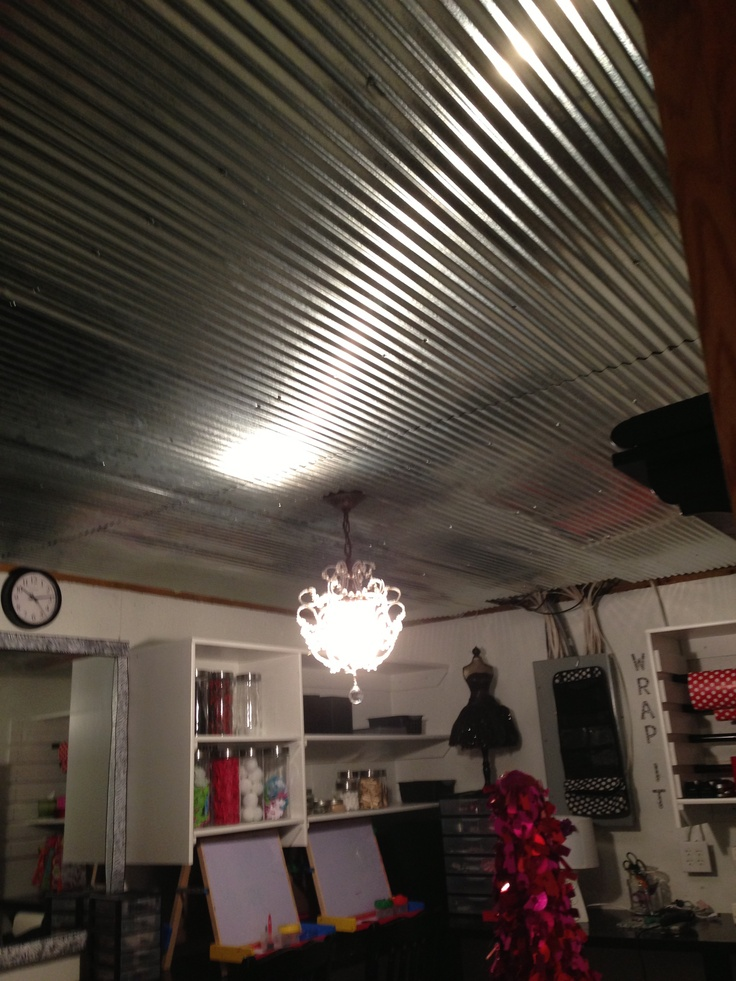 Pinterest Boutique metal ceiling very retro! New crystal chandelier a gift from Christmas... ( thanks Hubby )