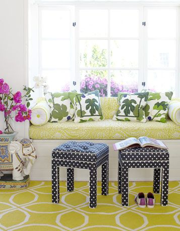 Love this sunny window seat with black & white polka dot upholstered stools!
