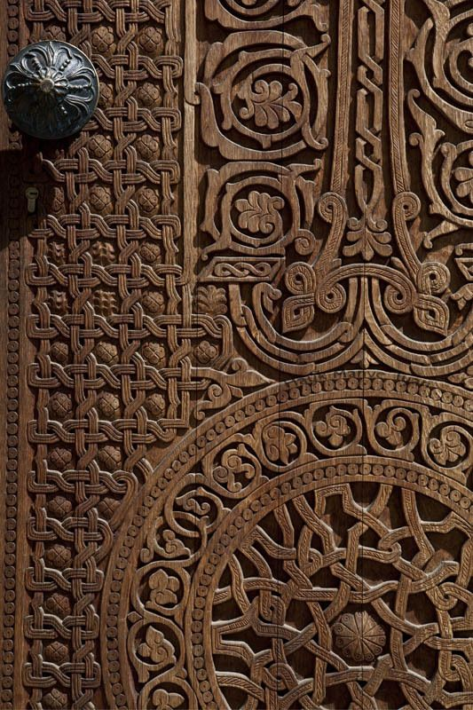 Door with wood carvings of Armenian Khatchkar -- evocative of rustic past