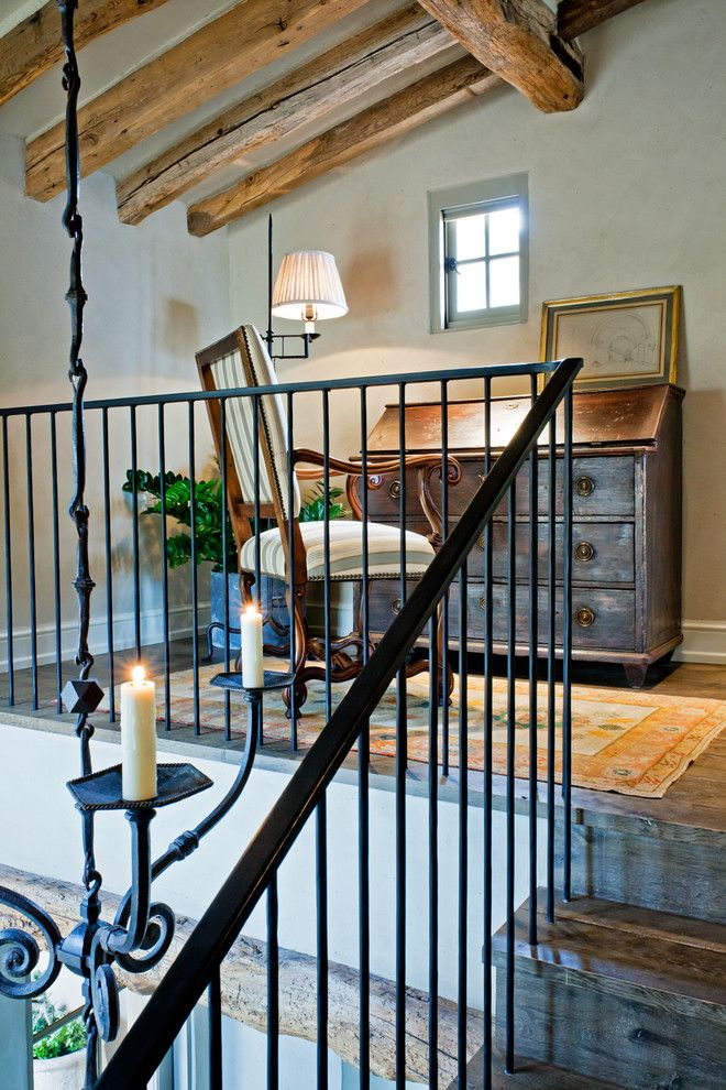 Wrought Iron Stair Railing Home Office Rustic with Area Rug Casement Windows Exposed Beams Loft