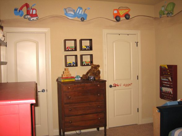 Construction Zone room - Love the painting up above. But also love the idea of the shadow boxes up above the dresser that showcase trucks