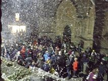 Artificial snow falling from the windows of Unity Hall onto the crowd waiting for the Christmas lights to be turned on in Newport, Isle of Wight. We don't usually get much snow here!