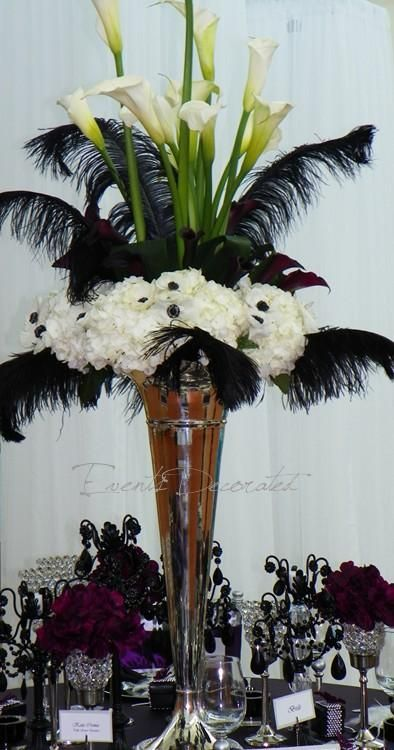 Tall vase with black ostrich feathers white callas