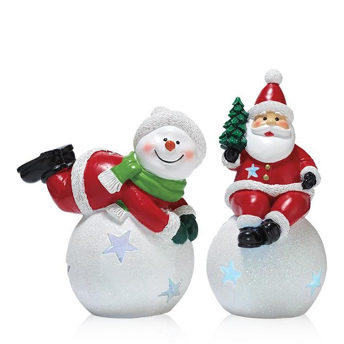 Deck the home with these jolly light-up Santa and Snowman figurines.FEATURES• Santa: Santa sitting on top of a snowball with star cut outs that have lights inside; Santa is holding a tree. • Snowman: Snowman is a laying position on top of a snowball with star cut outs that have lights inside; Snowman has Santa outfit with green scarf.MATERIALS• Polyresin Made in China*For decorative use only.Keep out of reach of children.