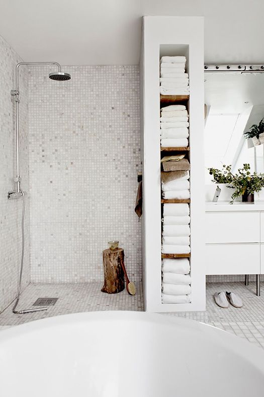 Love the shower, the cubbies for towels, and the awesome chunk of wood!