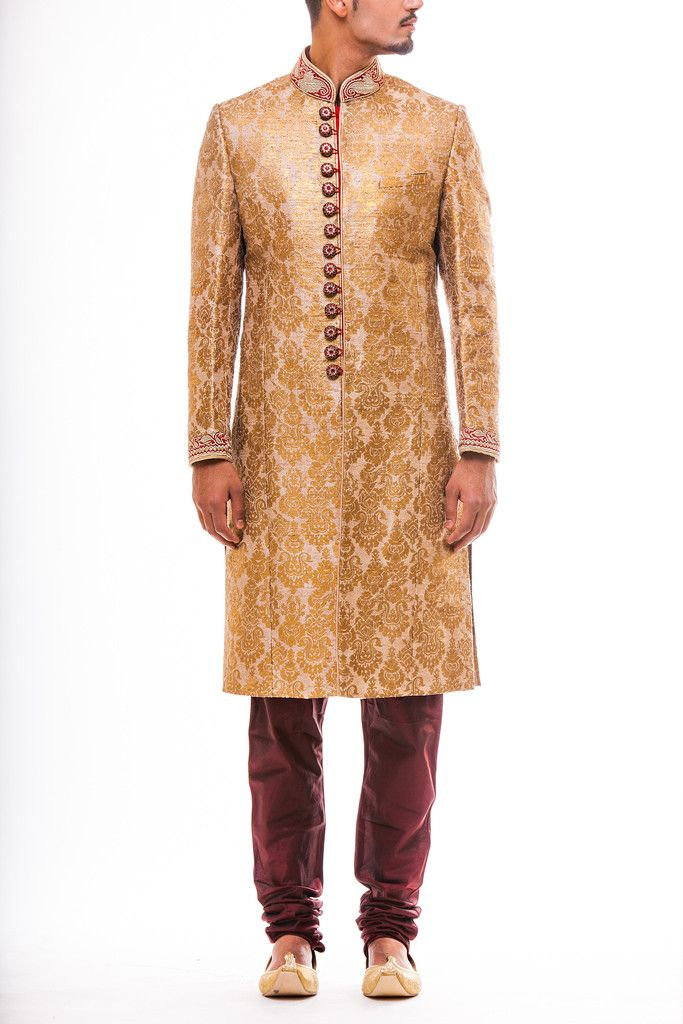 Exquisite all over gold foil block print Sherwani in Taupe Gold with kasab work on the collar and cuff and Swarovski Buttons paired with Maroon Churidaar