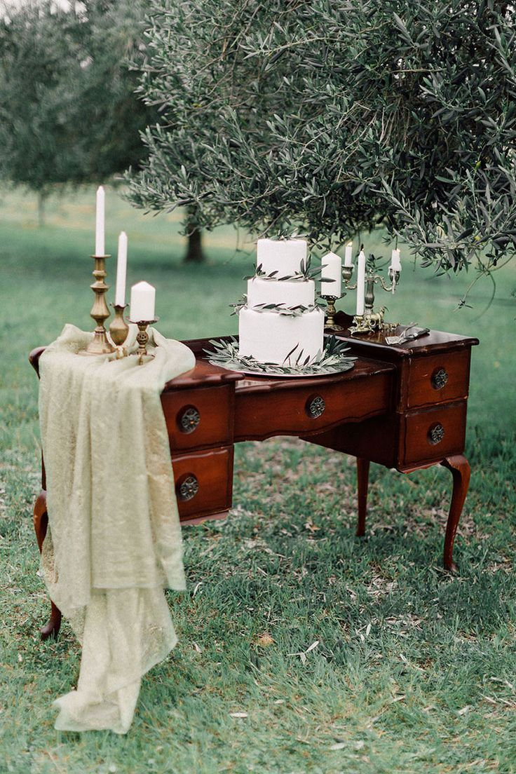 Olive leaf cake on vintage dresser | Kate Drennan Photography | See more: http://theweddingplaybook.com/romantic-bohemian-wedding-inspiration/