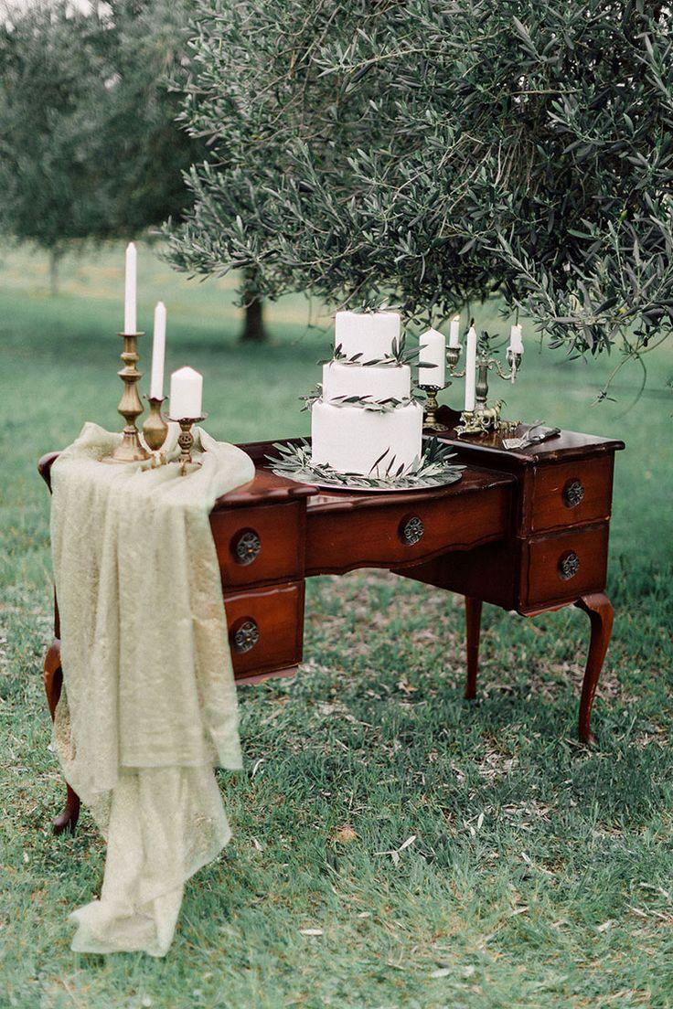 Olive leaf cake on vintage dresser | Kate Drennan Photography | See more: http://theweddingplaybook.com/romantic-bohemian-wedding-inspiration/