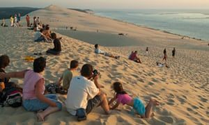 The 50 best beaches in the world Tourists on the Dune du Pyla at sunset, Arcachon, France