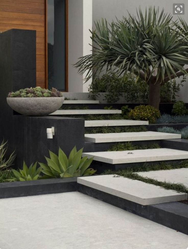 Floating steps with planting between to front entry
