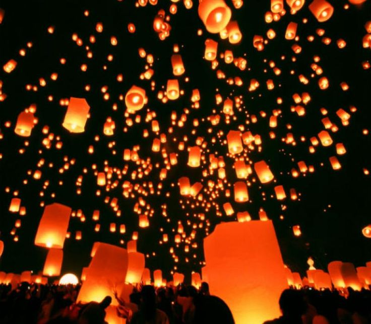"In Argentina, Christmas Eve means a sky full of ""globos"" - paper lamps with a light inside that float. It makes for a stunning view every Christmas Eve."