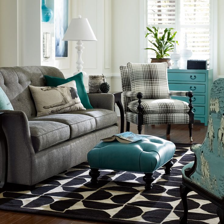 this is totally the look i want in my family room!! Got the gray couch and gray walls just need all the teal accents!!